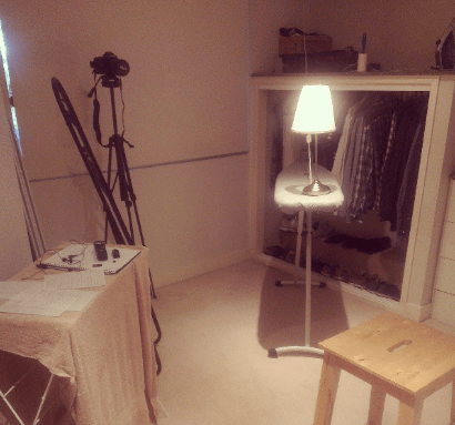 My video studio: An ikea lamp, an ironing board, the canon 6d camera and a stool for me to sit on, all in my bedroom.