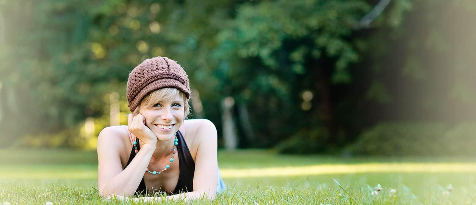 Tracy Raft lying down on grass