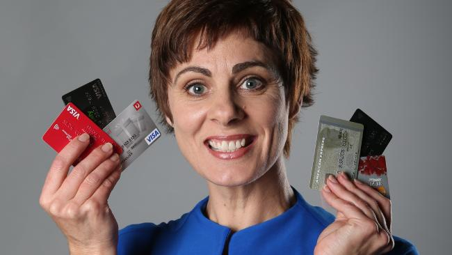 Heidi Armstrong holding up credit cards