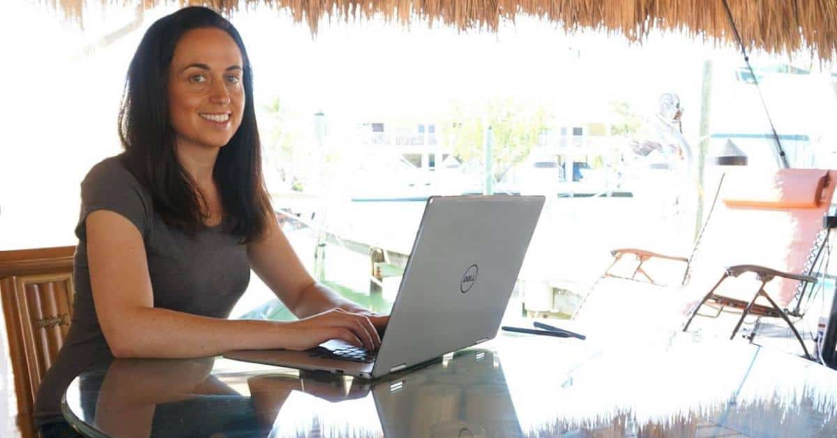 Amy Morin Writing Book On Laptop