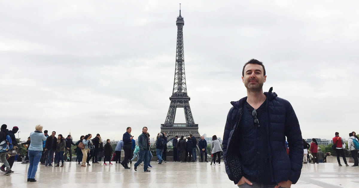 Yaro in front of the Eiffel Tower