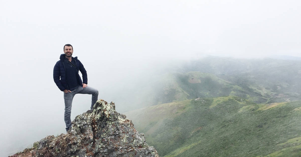 Yaro climbing foggy mountains in San Francisco
